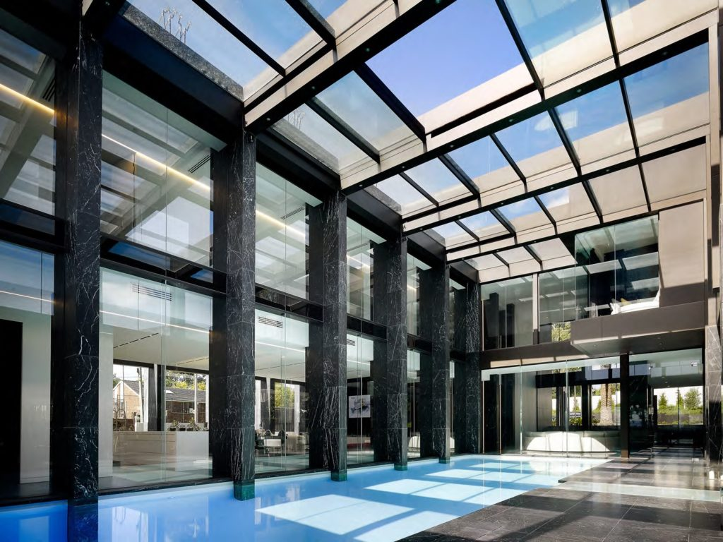 Templestowe luxury home automation Melbourne with glass roof above pool
